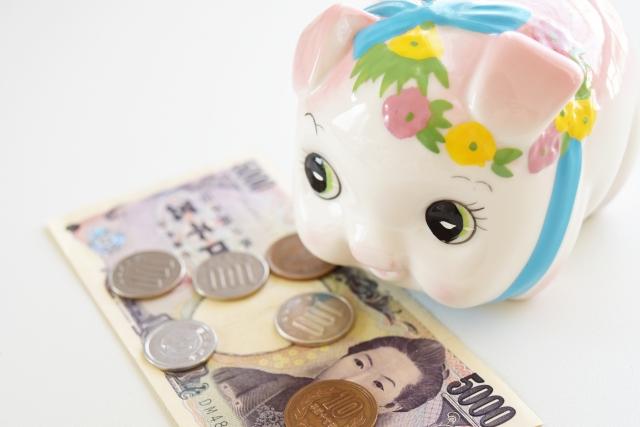 豚貯金箱と小銭と1000円札
