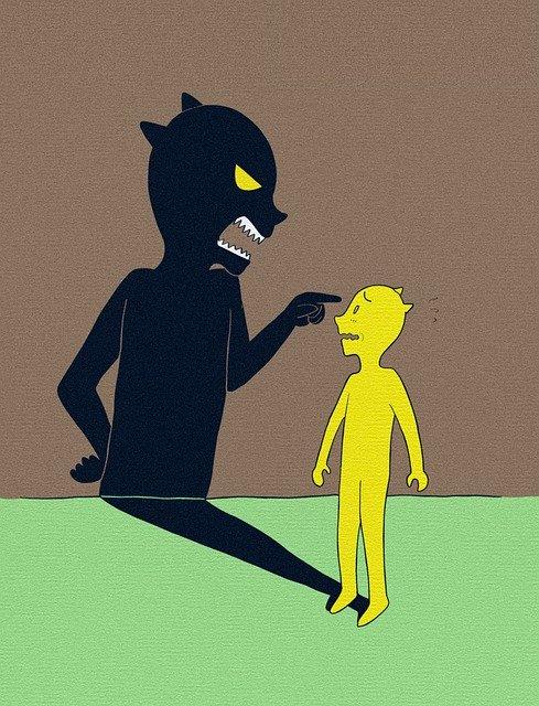 自分の影に指をさされる黄色い人