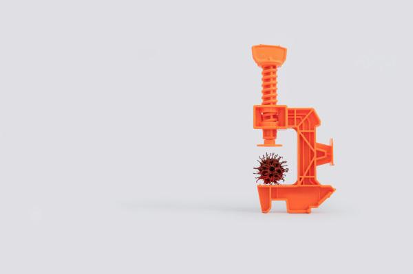 オレンジ色の顕微鏡と茶色のウィルス